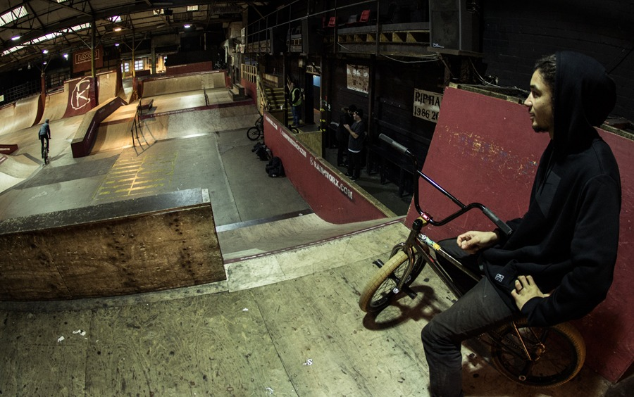 AK chilling and smashing out some moves on the flat bar.