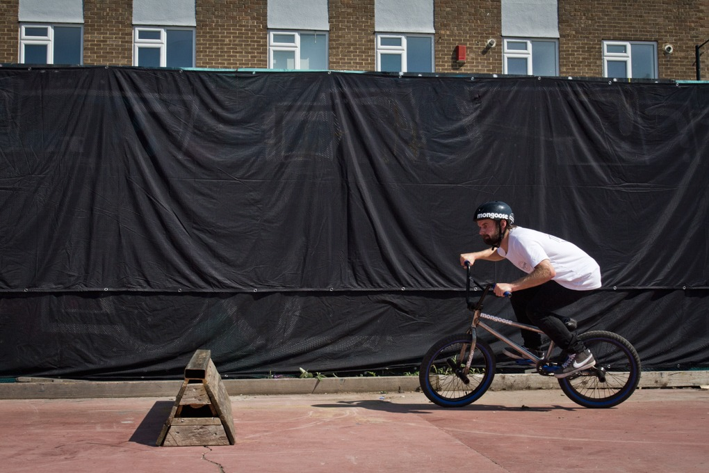 Firstly, find a smooth bit of flat ground. Approach your spot a bit quicker than walking pace. As you get within a couple of bike lengths of it, start carving into your spin. This needs to be more than you would for a 180, but not so much that it jackknifes you as you hop.