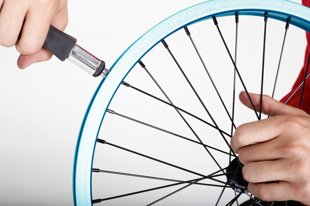 When you're sure that the spoke is in correctly, tighten it up so it sits on the nipple securely but still has some flexibility in it. With the new spoke in we can start truing the wheel. If your wheel was just buckled and didn't need a spoke replaced, you can pick up the instructions from here.