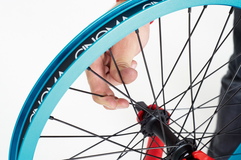 Once you've tightened up the buckled area, check the tightness of the rest of the spokes. If they seem loose, work around the wheel giving every spoke the same amount of turn until they're tight.